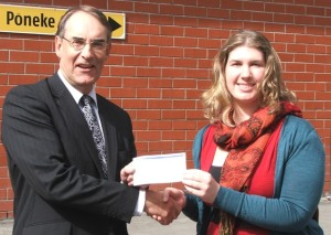 Bob Bishop of Certus Trust hands over $2,000 cheque to Nicola Clements of Odd Socks